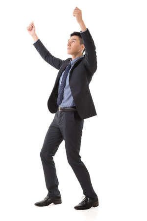 carry on: Holding pose of Asian business man, full length isolated. Stock Photo