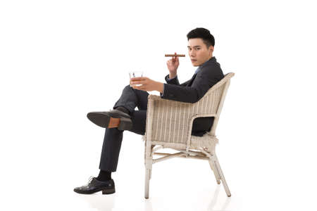 korean man: Cunning businessman of Asian sit on chair.
