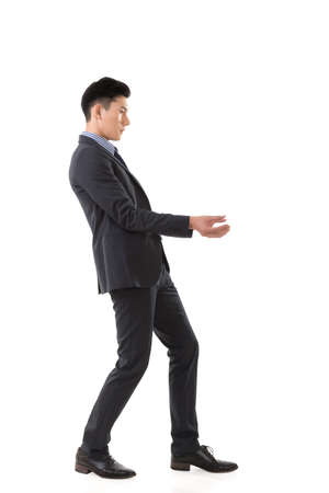 asian business man: Holding pose of Asian business man, full length isolated. Stock Photo