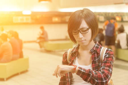 late 20s: Asian young girl wait for somebody in mall in Taipei, Taiwan. Stock Photo