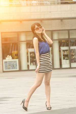 fashion style: Asian beauty in daytime in modern street in Taipei, Taiwan, Asia.