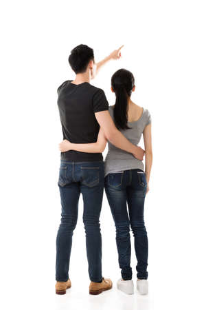 rear view of Asian young couple, full length isolated 写真素材
