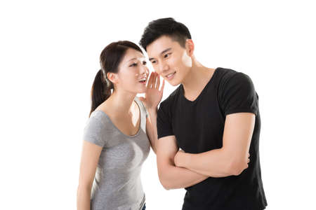 young Asian couple whisper, closeup portrait. Standard-Bild