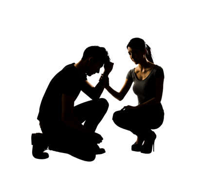 solace: Silhouette of one sad Asian man squat and his wife give comfort to him, full length portrait isolated Stock Photo