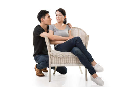 comfort: unhappy Asian young couple sit on sofa