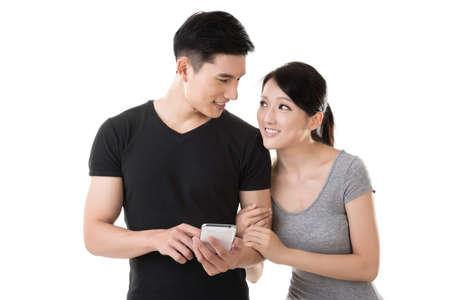 Asian young couple using cellphone, closeup portrait. Stock Photo