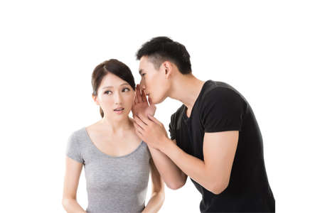 couples in love: young Asian couple whisper, closeup portrait. Stock Photo