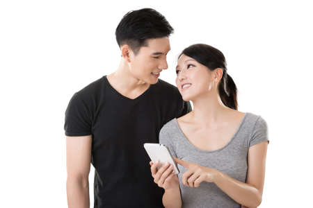 mobile sms: Asian young couple using cellphone, closeup portrait. Stock Photo