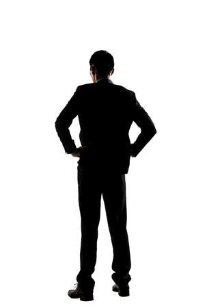 shadow man: Silhouette of Asian business man standing, full length portrait isolated
