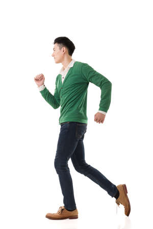 male models: Asian young man running, full length portrait isolated on white. Stock Photo