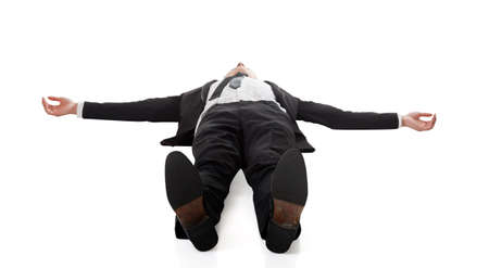 Asian businessman lying on ground, full length portrait isolated Stockfoto