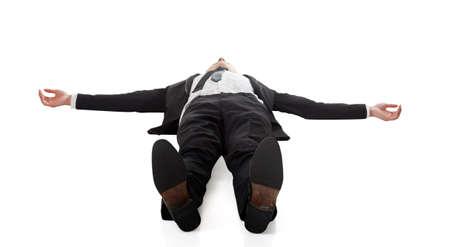 Asian businessman lying on ground, full length portrait isolated Foto de archivo