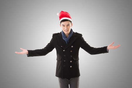christmas hat: Attractive Asian young man with christmas hat, closeup portrait.