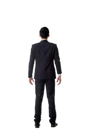 hombre pensando: confundida joven hombre de negocios de pie y pensando, retrato de longitud completa aislado Foto de archivo