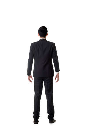 korean man: Confused young business man standing and thinking, full length portrait isolated