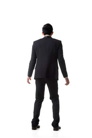 outraged: Asian business man surprised with outrageously and funny pose, full length portrait isolated