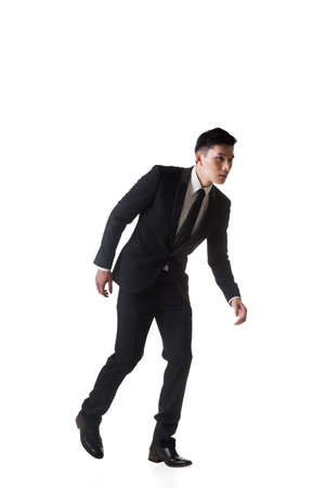 men in suit: Marionette pose, asian business man isolated Stock Photo