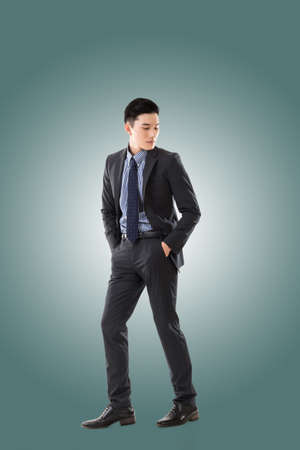 men in suit: Attractive young Asian businessman, full length portrait isolated