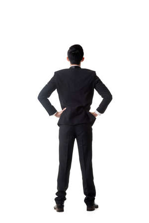 man meditating: Confused young business man standing and thinking, full length portrait isolated