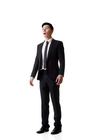 afraid man: Asian business man surprised with outrageously and funny pose, full length portrait isolated