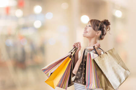 Shopping girl of Asian, closeup portrait isolated on white with clipping path. Stockfoto