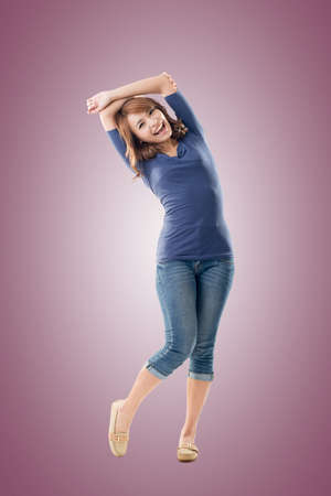 donna che balla: Excited Asian young girl, full length portrait isolated.