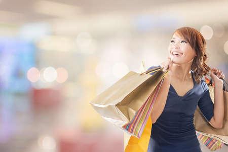 korean woman: Cheerful shopping woman of Asian holding bags. Stock Photo
