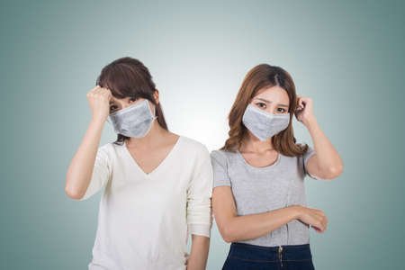 pollution: Sick woman with her friends with mask.