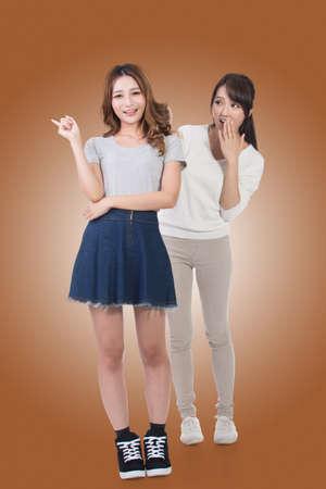 young women: Asian woman with her friend, studio shot portrait.