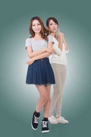 cheer full: Asian woman with her friend, studio shot portrait.