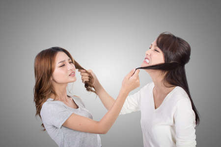female hands: Asian women fight and pull hair. Stock Photo