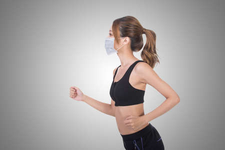 asian bodybuilder: Asian woman with mask in sport dress jogging, concept of air pollution, sick etc.