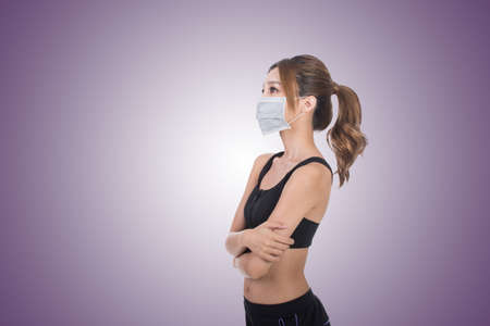 asian bodybuilder: Asian woman with mask in sport dress, concept of air pollution, sick etc. Stock Photo