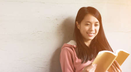 asian home: Asian beautiful woman read a book at home. Stock Photo