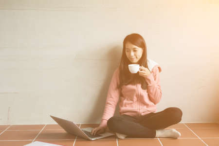 women coffee: Asian woman working at home.