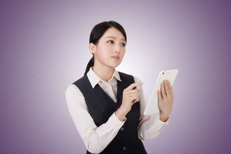 Online Business: asian young business woman using pad, closeup portrait Stock Photo
