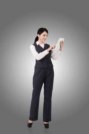 confident business woman: confident asian business woman, full length portrait