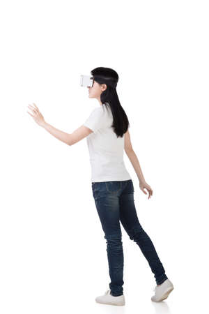 headset woman: Woman using the virtual reality headset