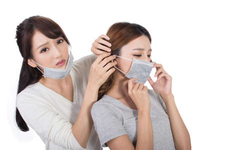 dust mask: Sick woman with her friends with mask.
