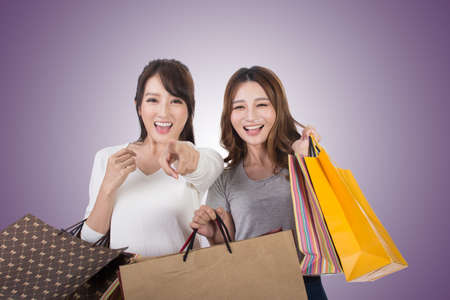 asian shopper: Asian shopping woman with her friends holding bags.