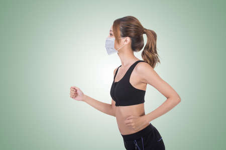girl sport: Asian woman with mask in sport dress jogging, concept of air pollution, sick etc.