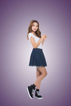 beautiful woman body: Young Asian girl, full length portrait isolated. Stock Photo