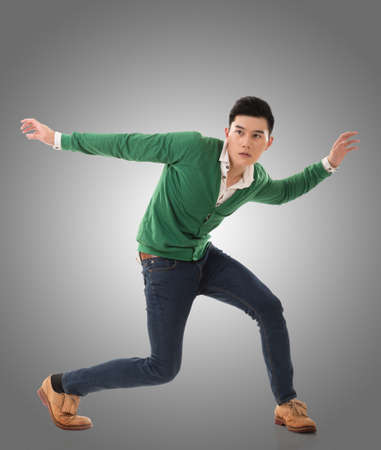 uomo felice: Asian young man dance, full length portrait isolated.
