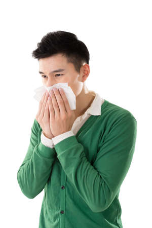 flu virus: Sneezing asian man, closeup portrait. Stock Photo