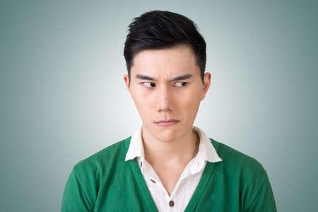 young asian: Funny facial expression, closeup Asian young man. Stock Photo