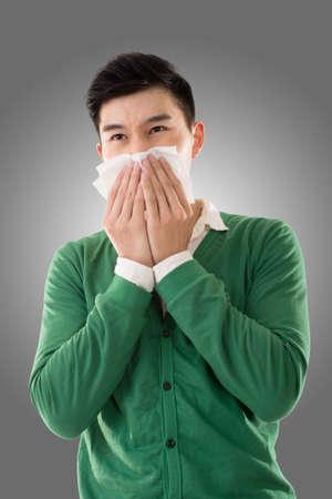 sneezing: Sneezing asian man, closeup portrait. Stock Photo