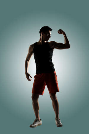 male athlete: Silhouette of young male athlete, full length portrait isolated