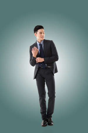 asian guy: Attractive young Asian businessman, full length portrait isolated