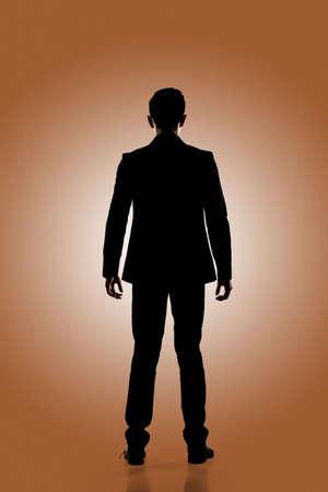 silueta hombre: Silueta del hombre de negocios de pie, aislado retrato de cuerpo entero.