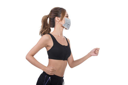 dust mask: Asian woman with mask in sport dress jogging, concept of air pollution, sick etc.